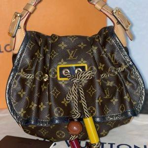 Authentic Louis Vuitton monogram Kalahari hobo PM